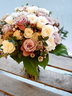 bridal bouquet of spray rose 'Majolica', rosa 'Old Dutch', waxflower 'Blondy', eucolyptus parvifolia and salal leaves