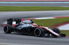 McLaren Honda's British driver Jenson Button races through a corner during the Formula One Malaysian Grand Prix in Sepang on March 29, 2015