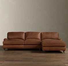 Setback rounded English arms and large loose cushions on the angled back give English Roll Arm a relaxed feel.