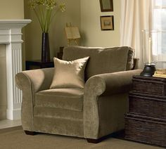 Pearce Armchair   Pottery Barn - I can imagine curling up in this one, which is my top chair-buying criterion.