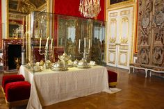 The dining table where Marie Antoinette and Louis XVI supped, while being attended to and watched by members of the court.