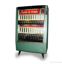 Art-o-mat.   I love this idea!  Small art dispensed form a repurposed cigarette machine