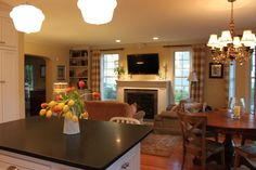 This is my favorite set-up - - small kitchen, small eating area open to a small family room.  No McMansions here!  love it!