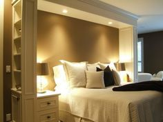 Headboard idea with lights and crown molding... bed area defined, w/custom built in side tables