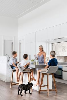 Jo with her sons (from left) Bailey, Ashton and Cooper, and Bruce the French bulldog. Caesarstone benchtop in Raw Concrete. Designer buy: Skal kitchen stools, $572/each, [Satara](http://www.satara.com.au/).