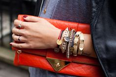 chunky bracelets and leather clutch