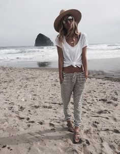 nice beach look include stripped pants hat and white top