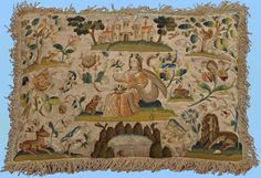 Flora England mid-17th century Needlework cushion  This rare silk embroidered cushion depicts Flora seated with a dog surrounded by typical birds, insects, flowers, and a large fish pond flanked by a stag and lion. A country house, trees, and various other motifs all surrounded by a fringe border complete this pleasing composition.  Flora is often used as a pictorial representation of spring.