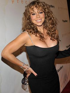 Mariah rocking curly bangs with long hair.