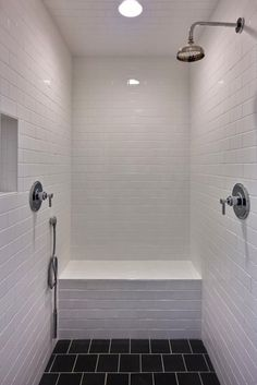 Castro Design Studio - great shower with white subway tiles shower surround, black tiles shower floor and rain shower head.