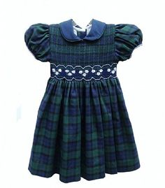 Green and navy plaid hand-smocked dress features embroidered flowers at the waist, puff sleeves and a peter pan collar. By Chantal Designs.