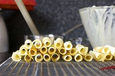 lots of rolled wafer cookies by smitten, via Flickr amazing cigarettes russes cookies. Next year's list?