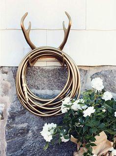 Deer antler hose holder...fitting since my last name is Deerman.