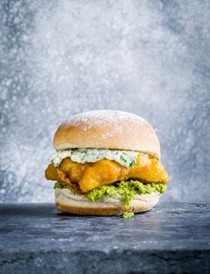 Fish Burger Recipe with Tartare Sauce Check out our crispy fish burger with vibrant mint mushy peas and homemade tartare sauce. This flaky fish bap may take a little effort but it's ready in just 30 minutes Fish Burger, Fish Sandwich, Pea Recipes, Sandwich Recipes, Dinner Recipes, Shellfish Recipes, Seafood Recipes, Fish And Chip Shop, Mushy Peas