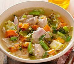 Slow cooker turkey soup.Shredded turkey with vegetables and mushrooms cooked in slow cooker.