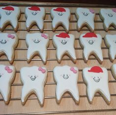 Tooth sugar cookies with cherry flavour icing for Tooth Fairy Party.