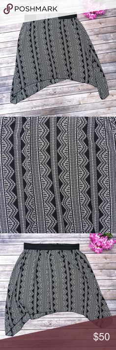 CCO ‼️ Divided Tribal Plus Size Skirt ✨ ★ NWOT, perfect condition. 💕 ★ This adorable black and white tribal skirt from Divided is perfect for spring, summer, and festival season! So cute! Elastic waist. 😻 ★ 100% Polyester. ★ NO TRADES! 🚫 ★ NO MODELING! 🚫 ★ YES REASONABLE OFFERS! ✅ ★ Measurements available by request and as soon as possible. 💁🏼 Divided Skirts
