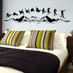 These vinyl wall decals depict a snowboarder in 10 different sequential poses over the mountains, which look like Breckenridge, if you ask me!