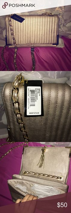 "Bebe Kyla Crossbody Dark Champagne  Rare color not sold in stores! Quilted purse with a chainlink strap, a textured front, and swinging tassel detailing. Gold-dipped edges. Ideal going-out bag. 100% Faux leather Height: 12"" (30 cm), width: 14.5"" (37), depth: 11.5"" (29 cm), handle drop: 12"" (30 cm) Magnetic clasp closure Imported bebe Bags Crossbody Bags"