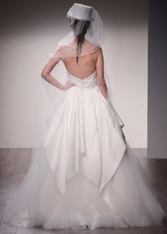 Ivory Tulle bridal ball gown, sweetheart neckline, draped bodice with natural waist, silky taffeta cascading overlay, sweep train.