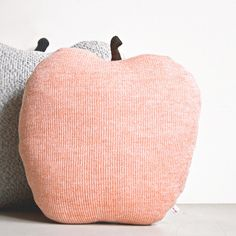 Just to round up our favorite objects that we fill our lives and houses with, let's bring on these lovely apple cushions by Studio Meez! Get one here.