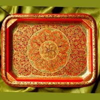 Kashmiri Art Trays-Papier mache began with the art of paper making in Kashmir. The art now manifestsitself on cloth, stone, wood and metal apart from moulded paper pulp.