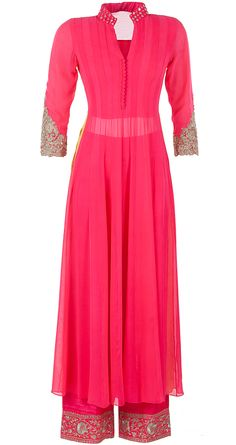 Neon pink mirror work kurta set by MANISH MALHOTRA. Shop at http://www.perniaspopupshop.com/designers-1/manish-malhotra