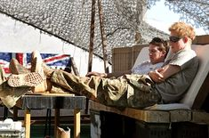 Prince Harry relaxes with fellow Pilots in their VHR (very high ready-ness) at the British controlled flight-line in Camp Bastion southern Afghanistan