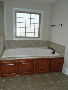 6 Drop In Tub With Timberlake Scottsdale Maple Cognac Cabinets Shown Windemere Venetian Bronze Plumbing Fixtures Accessories