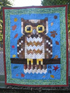 This afternoon, my eldest daughter and I visited a tennis court to hang the owl quilt for a picture. While in Minnesota, I searched ou. Owl Quilts, Animal Quilts, Barn Quilts, Owl Quilt Pattern, Quilt Patterns, Owl Patterns, Owl Fabric, Cotton Fabric, Architecture Tattoo