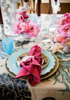 tablescape with turquoise, pink, shells, flowers and an animal print - but it all works so well together!