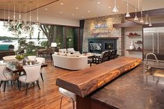 The kitchen in this Lake Minnetonka features dark wooden furniture throughout that also matches the window frames.