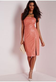 Look jaw to the floor smokin' hawt in this salmon pink midi dress. In a fierce faux leather fabric, strapless neckline and standout split to the front this dress is sure to turn heads. Team with nude lace up heels and matching clutch to c...