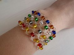 Design your own photo charms compatible with your pandora bracelets. I love how delicate this bracelet looks. Make your own Hogwarts Houses bracelet with this tutorial by Emily Van Leemput on Instructables. Pandora Bracelets, Pandora Jewelry, Jewelry Bracelets, Jewelery, Ring Bracelet, Necklaces, Bead Jewellery, Beaded Jewelry, Handmade Jewelry
