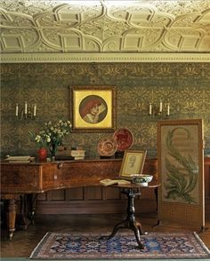 Part of the collection in the drawing room at Wightwick Manor. The walls are decorated with William Morris 'Dove and Rose' silk and wool wall hangings.Photo Simon Upton.  Country Life
