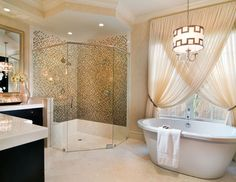 OMG ..when the house gets redone at some point ..the master bath will have a shower just like this, drapes in front of the window (where the tub will be) and a chandalier of some sort above it! haha