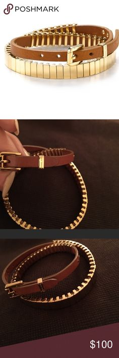 """Michael kors double wrap bracelet A heritage-inspired take on the wrap bracelet, this piece is styled in leather with gold plated detailing. Its buckle closure is distinctly Michael Kors with the signature logo  Adjustable buckle closure 16.75""""L Photo may have been enlarged and/or enhanced Steel/IP/leather Imported Michael Kors Jewelry Bracelets"""