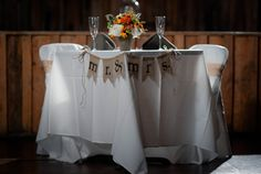 A sweetheart of a table, front and center on the dance floor at the Hayloft. Photo Credit: Glessner Photography