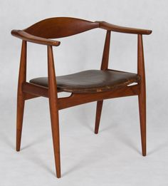 Teak and leather armchair, model CH-35, by Hans Wegner.