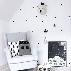 How sweet is this little nook in a mod black and white nursery?