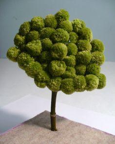 Use pom poms to make inexpensive, whimsical miniature trees.