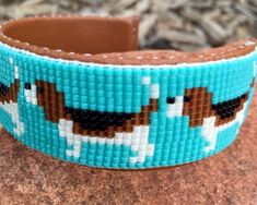 Items similar to Beaded Beagle Bracelet on a turquoise background. This bracelet is a beagle lovers joy. Handmade by the Artist. on Etsy Bead Loom Patterns, Jewelry Patterns, Handmade Beads, Handmade Jewelry, Glass Jewelry, Beaded Jewelry, Soldered Pendants, Bead Loom Bracelets, Metal Necklaces