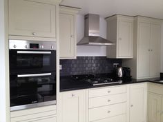 Dove Grey 'Neptune' kitchen with granite work top and Bosch hob & oven