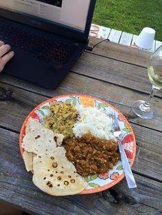 Vegan Indian feast for two in our backyard. Curry hash browns, baingan bharta (eggplant), naan bread, and jasmine rice. ❤