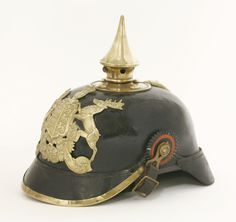 An Imperial German Württemberg Pickelhaube, the black leather helmet with a gilt brass plate and spike, with original ear rosettes and chinstrap, stamped to leather cover 'JR 180 I. B.', with original field cover with metal hooks Sold for £780 on 15th September 2015