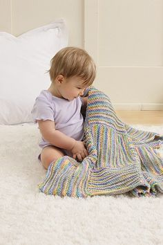 Cute rainbow baby afghan made with the Knook™. Buy this in a book bundle: http://www.leisurearts.com/sale/bundles/knook-baby-value-pa…