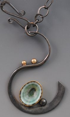 barbara umbel jewelry design - limpet necklace- oxidized green limpet shell from the Pacific coast of Mexico set in patinaed sterling silver and 14kt gold. $ 475.00