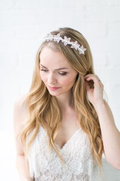 Simple and elegant crown is handcrafted from textured silk with acrylic coating in the shape of azalea blooms and adorned with pearl/gold centres. Perfect for minimalist bridal style lovers. – Available in pale ivory/gold & pale ivory/silver – Textured silk with acrylic coating – Velvet ribbon finishing – Designed and handmade in England pale ivory/gold – £80.00 x  …
