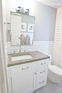 Like the penny tiles on the floor and the backsplash that extends behind toilet to the tub enclosure.