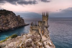 Swallow's Nest, Crimea (Ukraine) was built on Aurora Cliff between 1911 & 1912. Baron von Steingel, a Baltic German noble who had made a fortune extracting oil in BakuIt, acquired the wooden cottage that stood on the cliff & replaced it with the compact castle. The castle is Neo-Gothic style & was designed by the Russian architect Leonid Sherwood.